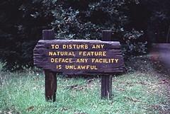 To disturb any natural feature deface any facility is unlawful.... (birdgal5) Tags: california marincounty millvalley 35mmslide mounttamalpaisstatepark march1980 55mmf35micropc nikkormatel mounttamalpaissp mountaintheaterentrance todisturbanynaturalfeature