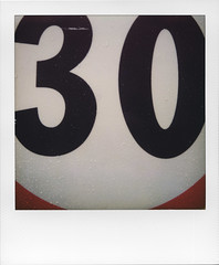 30 and no more than 30 (ale2000) Tags: red white black water rain sign 30 polaroid drops streetsign beta numbers 600 round type g3 rosso bianco slr680 nero impossible gen3 testfilm
