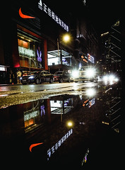 Guangzhou.night.1 (Jeremy Langley) Tags: street city reflection car rain night drive mirror driving nightlights headlights nike justdoit kurb