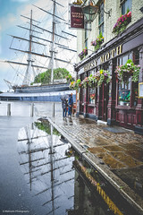 the Moth & the Clipper (sara.wendelmelhuish) Tags: summer urban london rain thames umbrella reflections square puddle boat tea greenwich streetphotography cuttysark clipper teaclipper gypsymoth se10 londonphotography