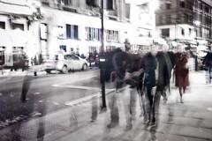 Midnight Stroll (Aditya Indrajaya) Tags: street uk family winter vacation england people urban bw london walking blurry britain voigtlander group midnight londres brexit
