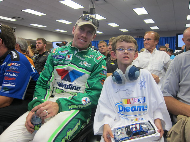 Carl Edwards with a NASCAR Dreams child
