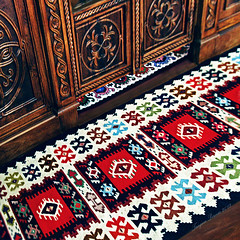 "Pirot Kilim at the Royal Doors.  : """" (Tanjica Perovic Photography) Tags: wood red art wool colors carpet photography design pattern handmade folk geometry vibrant unique interior crafts traditional serbia rich culture craft rug balkans woven brand orthodox weaving weave kilim authentic balkan srbija woodengraving catchycolorsred  pirot staraplanina sheepswool naturaldyes  southeasteurope    balkanmountains royaldoors dveri  naturallydyed handcarvedwoodwork southeastserbia multycoloured pirotskicilim  pirotkilim pirotserbia tanjicaperovic  pirotskiilim pirotski pirotsrbija  tanjicaperovicphotography  iconostasiswoodwork flattapestrywovencarpet fotografijepirota"