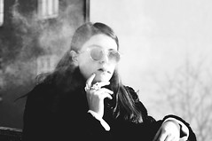 (juntaoren) Tags: winter bw girl cigarette smoke smoking sunnies