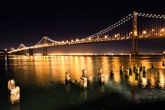 Bay Bridge At Night (Jeremy Duguid) Tags: california bridge night canon landscape lights oakland bay san francisco long exposure jeremy clear embarcadero pilings duguid 50d jeremyduguid