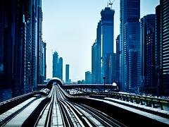 Dubai metro (miemo) Tags: city travel urban buildings highway dubai skyscrapers traffic metro uae middleeast rail olympus arabia rails unitedarabemirates ep1 sheikhzayedroad financialcentre explored metrorails