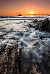Jagged Wembury Rocks (paulwynn-mackenzie.co.uk) Tags: sunset sea sun blur beach clouds rocks waves sony a33 jagged slt wembury digitalcameraclub
