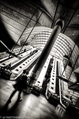 The Asymmetrical Station [EXPLORED] (Aaron Yeoman) Tags: city uk greatbritain travel light england people urban blackandwhite bw london glass lines station architecture modern underground subway blackwhite europe arch metro unitedkingdom sony curves escalator perspective railway arches line dome gb docklands tubestation londonunderground escalators subwaystation alpha curve canarywharf vignetting vignette hdr highdynamicrange thetube jubileeline metrostation tfl lul theunderground undergroundstation isleofdogs rapidtransit towerhamlets canarywharftubestation northeastlondon a700 metropolitanrailway tamronspaf1750mmf28xrdiii canarywharfundergroundstation sonyalpha700 dslra700