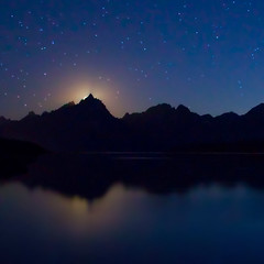 "Moon setting behind Grand Teton (IronRodArt - Royce Bair (""Star Shooter"")) Tags: park sky moon mountain nature set night dark stars evening twilight shiny long exposure heaven glow shine nightscape time dusk infinity space deep peak grand twinkle astro sparkle galaxy astrophotography astronomy grandtetons universe setting exploration range cosmic starry cosmos astrology moonset constellation refection distant starlight grandtetonnationalpark starrynightsky"