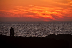 A stolen kiss (iZak Ben (2nd)) Tags: sunset orange silhouette kiss morocco maroc smack coucherdesoleil rabat baiser frenchkiss océan