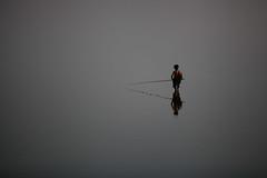 Fishing at dusk (Lil [Kristen Elsby]) Tags: travel lake reflection fishing fisherman topf50 asia dusk burma topv1111 bama frombehind getty myanmar gettyimages amarapura ubeinbridge fishingrod ubein intha travelphotography taungthaman myanma taungthamanlake canon5dmarkii myanmar2012