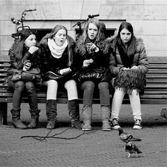 Schoolgirls & pigeons... (Akbar Simonse) Tags: street girls people urban bw holland netherlands monochrome bench square zwartwit candid pigeons streetphotography denhaag thehague streetshot straat straatfotografie straatfoto straatfotograaf dedoka akbarsimonse