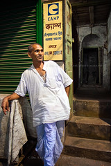 In Front Of The Door (Satyaki Basu) Tags: street portrait people india college canon eos book store indian lane 1750 tamron kolkata bengal calcutta westbengal 450d gettyimagesmiddleeast