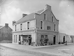 Shortis's Shop and Bar (National Library of Ireland on The Commons) Tags: ireland signs shop bar bench advertising hardware chair mainstreet barrels cardiff kerry ballybunion canes baskets biscuits cans jacobs cadburys groceries merchant tins munster spades bunkerbar 1900s pebbledash glassnegative casks walkingsticks canechair rowntrees publican cadburyschocolate ballybunnion allanline robertfrench bunkerlounge williamlawrence nationallibraryofireland cliffroad lawrencecollection cadburyscocoa shortis marybrowne wrjacobco wagilbey williamshortis annieshortis anniebrowne norahbrowne patrickshortis castlegrandjjwhiskey jjwhiskey spillerskephewsltd rowntreeslemonade shortisfamily
