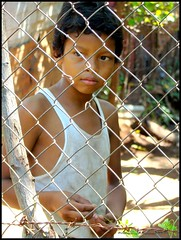 child of hope ..... marcel (ana_lee_smith_in_nicaragua) Tags: poverty charity travel school light shadow portrait fence children photography hope education child mud photojournalism happiness chainlink granada learning nicaragua santaana organization barrio means literacy nonprofit rainyseason thirdworld empowerment selfesteem developingnation childrenatrisk hopeforthefuture childrenofhope villageofhope empowermentinternational childofhope villaesperanza analeesmith kathyaadams empowermentthrougheducation photosofnicaragua analeesmithincuba photosofgranada analeesmithinnicaragua