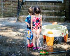 DSCF0679 (djandzoya) Tags: water backyard play sam candid siblings sprinkler fujifilm provia fenya