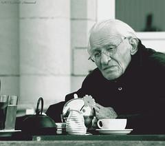 Portrait (Natali Antonovich) Tags: portrait monochrome glasses seaside cafe lifestyle tradition relaxation oostende seashore terras seasideresort reverie belgiancoast seaboard
