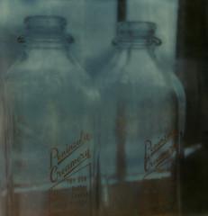milk bottles (lawatt) Tags: film glass milk bottles instant slr680 developing peninsulacreamery theimpossibleproject color600
