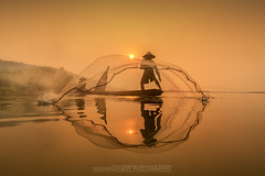 Fisherman Sunset in Thailand (noomplayboy) Tags: life travel sunset people mountain reflection water sunrise landscape thailand fisherman asia country thai noomplayboy nanutbovorn