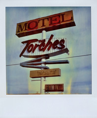 The Torches Motel (Nick Leonard) Tags: california old blue orange classic film sign yellow vintage polaroid route66 neon nick roadtrip scan retro signage neonsign arrow vacancy timeless 1960 timezero motelsign expiredfilm barstow landcamera polaroidsx70 colortv instantfilm epson4490 expired2002 polaroidsx70landcamera polaroidtimezero polaroidtimezerofilm integralfilm nickleonard colortvbyrca polaroidtz thetorchesmotel believeinfilm