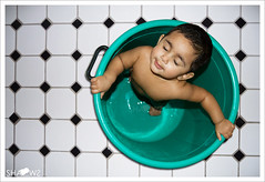 Its Bath Time (Sh@dows) Tags: green girl canon pose photo bath shadows child flash flashphotography 7d monday babybath shdows sarin aami babymodel greenbucket amayah itsbathtime sarinsoman  canon7d  nizhal   amayahsarin  nizhalkoothu playofmyshaodws sarinsomancom