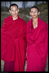 Red Young Monks (aleemsm) Tags: red cold smile glasses healthy bhutan serious young monastery monks cloth wraparound
