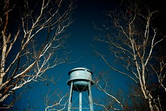 Estill, SC (MilkaWay) Tags: trees winter watertower southcarolina bluesky baretrees estill hamptoncounty