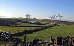 whoosh (littlestschnauzer) Tags: uk blue west apple stone skyline rural march countryside energy skies wind many yorkshire windmills hills fields walls tops lots 4s 2012 huddersfield turbines iphone kirklees