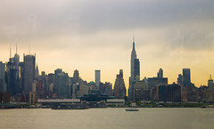 Skyline from Inside the Bus (-gunjan) Tags: nyc newyorkcity morning urban sun newyork water skyline buildings landscape dawn interesting manhattan gmphotography