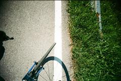Grey / white / green. (Markus Moning) Tags: road camera shadow white green film bike bicycle wheel analog 35mm buch toy grey austria sterreich fantastic fuji slim superia strasse rad wide felt plastic 200 fujifilm expired viv vivitar ultra schatten kamera tyre renner moning rennrad reifen vorarlberg rennvelo at markusmoning