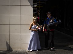 Pizza and the Bride (Leanne Boulton) Tags: life street city uk wedding light shadow portrait people urban woman sunlight man color colour detail male texture beautiful beauty face fashion female contrast canon bride scotland living alley eyecontact shadows dress faces natural humanity outdoor expression glasgow candid 28mm culture streetphotography surreal streetlife wideangle scene pizza odd human alleyway shade 7d delivery gown juxtaposition society depth tone facial candidstreetphotography candideyecontact