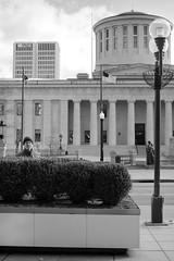 At the Statehouse (Stephen A. Wolfe) Tags: street columbus ohio usa selfportrait poster 50mm blackwhite downtown streetphotography oh juststreetphotography afnikkor50mmf14 blackandwhitestreetphotography niksoftware apertureusers nikond700 50mmf14shooters centralohiophotographers niksoftwarephotoshare petapixel photographersontwitter appleaperture3 thisweekinphoto silverefexpro2 cotaproject