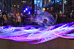 Illuminate Yaletown (Eyesplash - There is a change in the air.) Tags: show camera people reflection ice rain fire lights melting action creative photographers tourists event yaletown annual hulahoop crowds illuminate austinminicooper creatibity axemadeofice