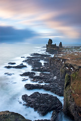 Pillar Rocks - Lndrangar - Snfellsnes - Iceland (Arnar Bergur) Tags: ocean sea sky orange snow 20d grass clouds canon landscape island iceland rocks long exposure pillar cliffs arnar 1740 sland lndrangar horazion