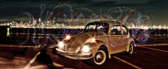 HR 8938 Cephei (Eric Schofhauser) Tags: seattle city light sea water car skyline vw night photoshop vintage bug dark painting washington costume crazy cool graphics long exposure downtown mask pacific northwest head beetle sound alki mysterious electronica streaks visualization beams trance puget dubstep deadmouse deadmau5 chillstep