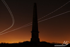 Passing Planes (Nicholas Gray) Tags: light england sky holiday motion blur brick monument field weather stone composite night speed port photoshop dark newcastle stars point landscape lights star hall fly flying airport movement nikon long exposure skies slow nocturnal infinity air flash north transport jet tourist astro east landing clear trail northumberland northumbria pollution return obelisk planes shutter land vista astronomy passenger blink approach visiting universe seaton edit jetset d300 delaval