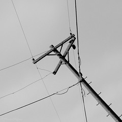 Angles (left) (Mark.W.E) Tags: winter sky bw snow wisconsin blackwhite cloudy telephonepoles telephonewires