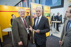 Peter Ramsauer talks with Bill Meahl at the DHL Stand