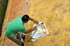 Wrapping the Fish (Hasnuddin Photography) Tags: fish newspaper market wrap malaysia wrapper kota khadijah siti pasar ikan kelantan surat tradisional bharu khabar bungkus suratkhabar