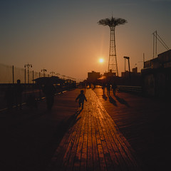chasing the sun (Barry Yanowitz) Tags: ocean nyc newyorkcity sunset ny newyork 6x6 film beach brooklyn mediumformat coneyisland amusement sand ride sunsets 120film scanned amusementpark rides filmcamera amusements nycity amusementparks fujivelvia50 parachutejump 718 rolleicordv