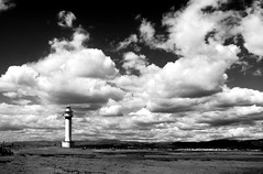 Faro en blanco y negro (vallencantado) Tags: ocean light sea sky blackandwhite costa lighthouse storm blancoynegro luz clouds dark faro coast mar quiet barcos ships delta cielo nubes tormenta guide sailor salvation calma oceano oscuridad guia guiding marinero guiar salvacion ilumiancion