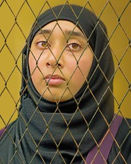 Behind  the fence (DeeMac) Tags: portrait trapped hijab fenced 45mm jailed hss behindthefence em5 slidersunday