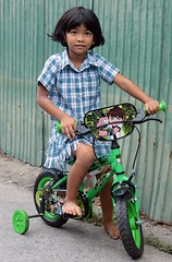pretty girl on a bicycle (the foreign photographer - ) Tags: green girl bicycle training portraits thailand nikon pretty child bangkok wheels lard bang bua khlong bangkhen d3200 phrao apr302016nikon