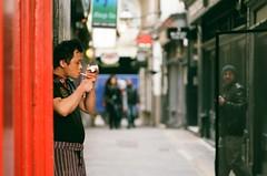 Cigarette break in China Town (Robert Bosson) Tags: chinatown nikonf100 fujifilm londonchinatown fujicolor nikkor105mmf25 fujicolorc200 35mmfilmphotography nikonf100nikonfilmcamera