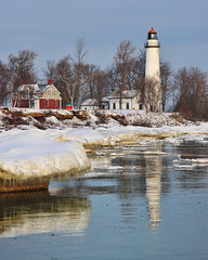 Wintertime at Aux Barques Lighthouse, Port Hope, Michigan (Michigan Nut) Tags: blue trees winter red sky lighthouse snow reflection ice nature water geotagged frozen midwest michigan floating greatlakes icicles lakehuron pointauxbarqueslighthouse