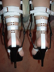 Rear View of Heels and Straps Suspended (KAFOmaker) Tags: sexy leather fetish spread high shoes highheels braces sandals bondage strap heels heel cuff ankle bound buckle brace straps sandal cuffs appliance buckles ankles restraints rivet bracing orthopedics whiteandblack restrain kafo restrained orthopedic cuffed strapped restraining spreader spreaders buckling br