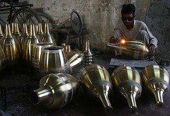Brass vases (saqib_khanphoto) Tags: pakistan light man great workshop karachi sindh welds papp saqibkhan brassvases