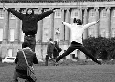 Star Jumpers (James_2nd) Tags: uk blackandwhite bw tourism star jumping bath royal streetphotography tourists crescent
