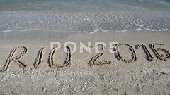 062777773-rio-2016-inscription-sand-beac (daria.boteva) Tags: world brazil game beach water beauty lines childhood silhouette sport rio horizontal riodejaneiro composition writing handwriting outdoors design team sand message symbol drawing background text year wave competition nobody nopeople newyear ring clean number international brazilian olympics script drawn athlete simple handwritten advertizing olympicgames competitions 2016 olympicrings summergames rio2016