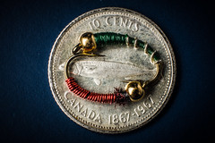 Smaller than a coin... (Fallen Archer) Tags: mackerel dime flyfishing yinyang canonef50mmf14usm chironomid brassie macromondays canoneos40d lastolitesoftbox canon600exrt smallerthanacoin kenko30mmextensiontube canadian1967commemorativedime